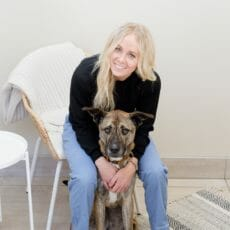 Veterinarian sitting in a chair with a brown dog