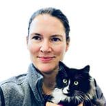 Medical director holding a black cat