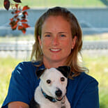 Managing partner of a veterinary clinic with a white dog
