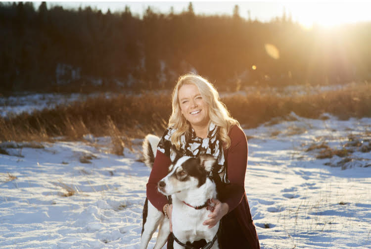 Veterinary practice manager sitting with a husky
