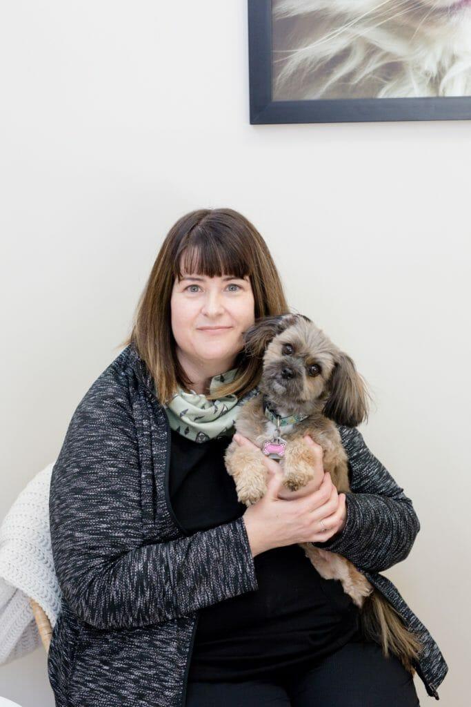 Registered veterinary technician holding a dog